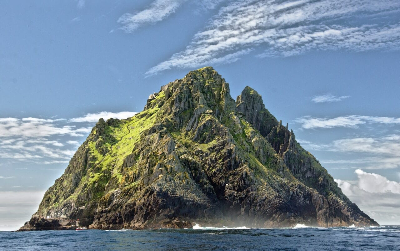 green-and-brown-mountain-in-the-middle-of-the-ocean-3900617